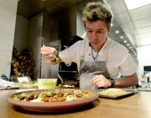 Chef Mathew Lackey, of Arcana Restaurant, in Boulder, plates a carrot, sheep's milk cheese and lamb dish. Cliff Grassmick Staff Photographer February 25, 2016